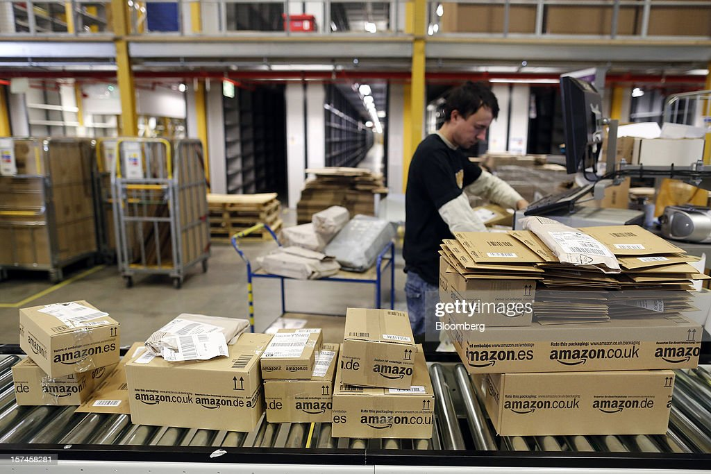 An employee processes customer orders at the Amazon.co.uk Marston Gate 'Fulfillment Center,' the U.K. site of Amazon.com Inc., in Ridgmont, U.K. on Monday, Dec. 3, 2012. U.K. consumer confidence unexpectedly increased to an 18-month high in November as Britons become more optimistic about the economy and their finances, GfK NOP Ltd. said. Photographer: Simon Dawson/Bloomberg via Getty Images