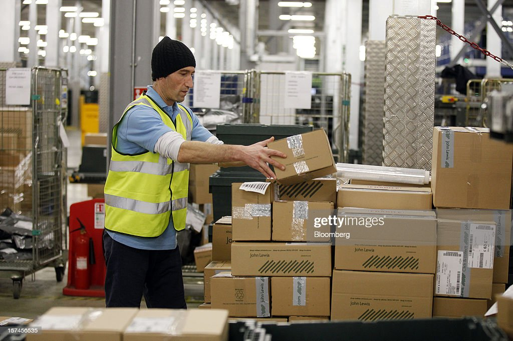An employee processes outgoing orders ahead of dispatch from the John Lewis Plc distribution centre in Milton Keynes, U.K., on Monday, Dec. 3, 2012. An index of U.K. retail sales rose to a five-month high in November, according to a monthly report from the Confederation of British Industry. Photographer: Simon Dawson/Bloomberg via Getty Images