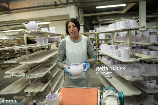 An employee produces crockery in the Emma Bridgewater factory which employs around 185 people and manufactures 13 million pieces of pottery each year...