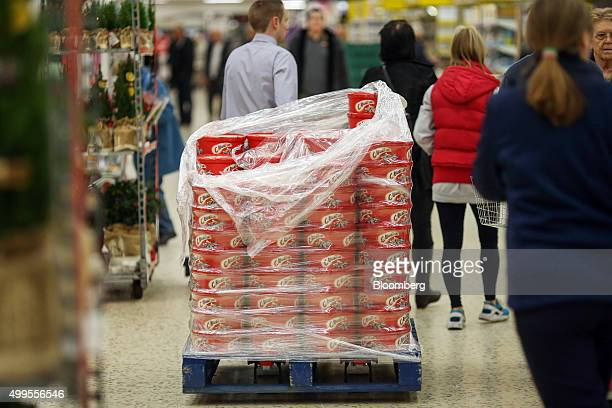 An employee pulls pallet loaded with a stack of Celebrations chocolates manufactured by Mars Food UK Ltd at the Tesco Basildon Pitsea Extra...