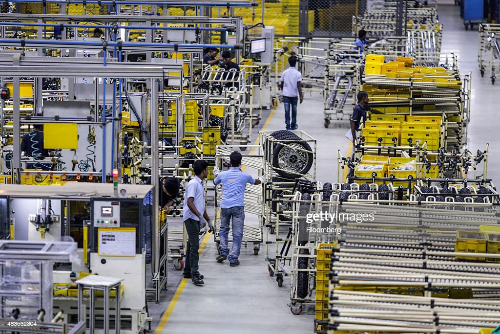 An employee pushes a cart on the production line at a Royal Enfield Motors Ltd manufacturing facility in Chennai India on Tuesday July 14 2015 In a...
