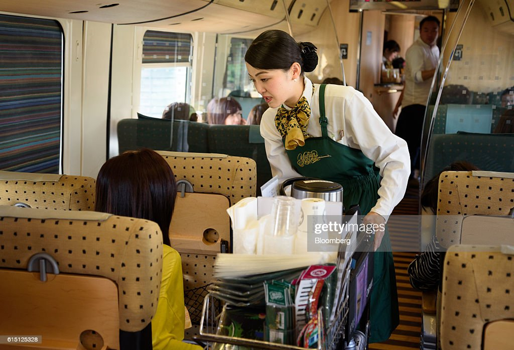 An employee pushes a food cart onboard the Yufuin No Mori limited express service train, operated by Kyushu Railway Co., as it travels from Hakata to Yufuin in Fukuoka Prefecture, Japan, on Tuesday, Oct. 11, 2016.JR Kyushu, the state-owned bullet-train operator seeking to raise as much as 416 billion yen ($4 billion) in an initial public offering, plans to reduce its reliance on Japan by investing in residential and office properties in Southeast Asia, its chairman said in an interview. Photographer: Akio Kon/Bloomberg via Getty Images