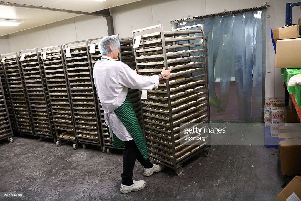 An employee pushes a trolley of unbaked Cornish Pasties into a freezer on the production line of the Cornish Premier Pasties Ltd. in St Columb, Cornwall, U.K., on Thursday, April 28, 2016. Cornish Pasties are one of the U.K.'s food products that are protected against imitation throughout the European Union under regulations that recognize regional and traditional foods. Photographer: Simon Dawson/Bloomberg via Getty Images