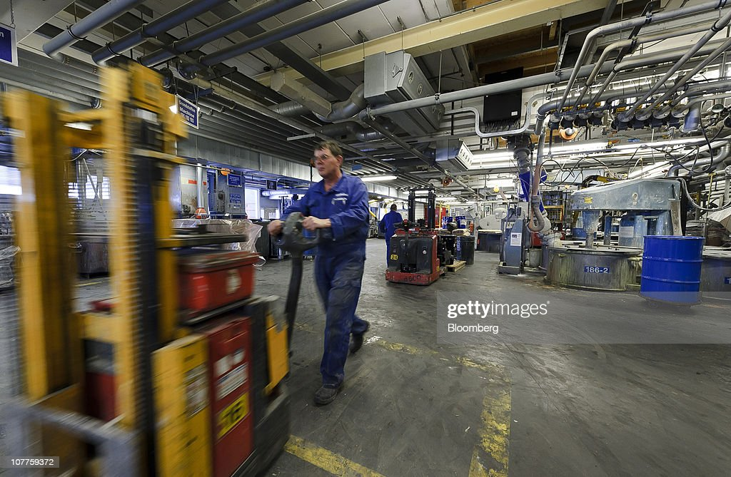 An employee pushes a trolly through the Akzo Nobel NV paint