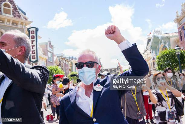 An employee reacts during the official reopening ceremony at Walt Disney Co's Disneyland Resort on June 18 2020 in Hong Kong China