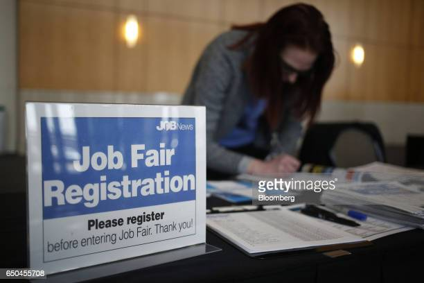 An employee registers job seekers during a Job News USA career fair in Overland Park Kansas US on Wednesday March 8 2017 Applications for US jobless...