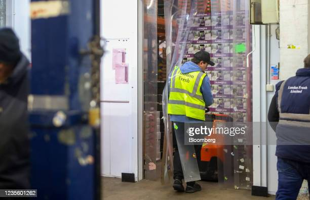An employee removes a pallet of aubergines from a chilled area in the Buyers Walk at New Covent Garden Market wholesale market in London, U.K., on...