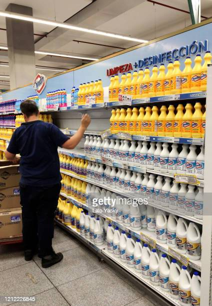 An employee restocks bleach shelves at a Coto Hipermaket on March 13 2020 in Buenos Aires Argentina President of Argentina Alberto Fernandez banned...
