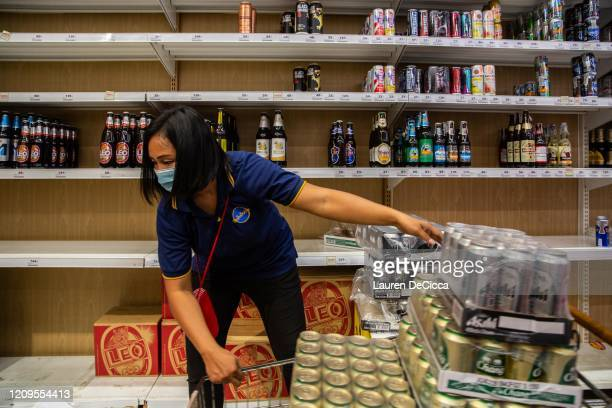 An employee restocks cases of beer at a Big C supermarket the night before a citywide alcohol ban on April 9 2020 in Bangkok Thailand Thai...