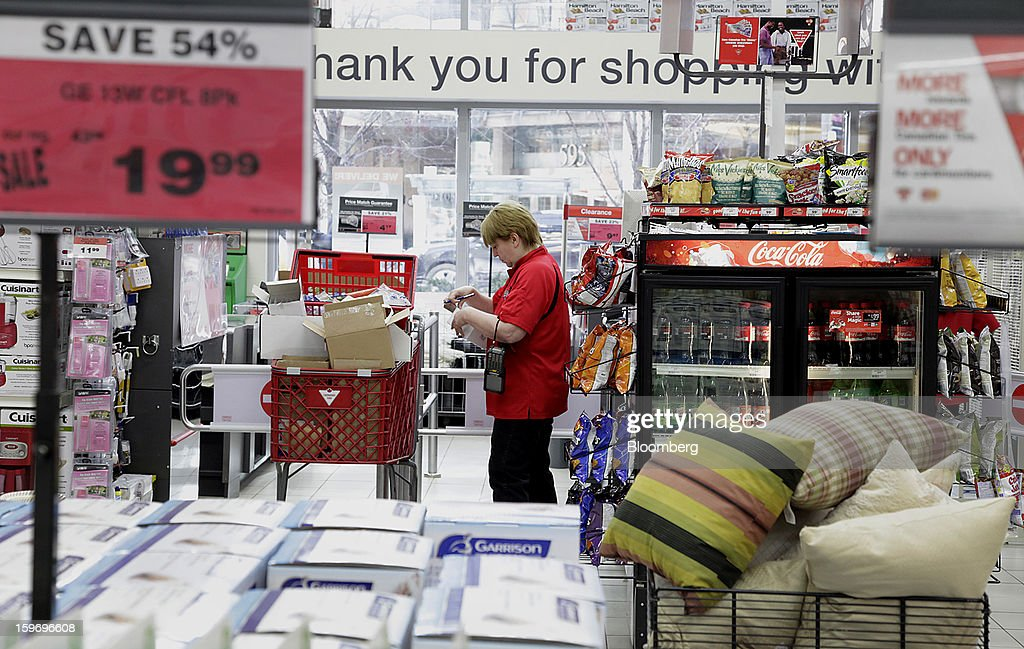 An employee restocks merchandise at a Canadian Tire Corp. store in Toronto, Ontario, Canada, on Friday, Jan. 18, 2013. STCA - Statistics Canada is scheduled to release retail sales data on Jan. 21. Photographer: Reynard Li/Bloomberg via Getty Images