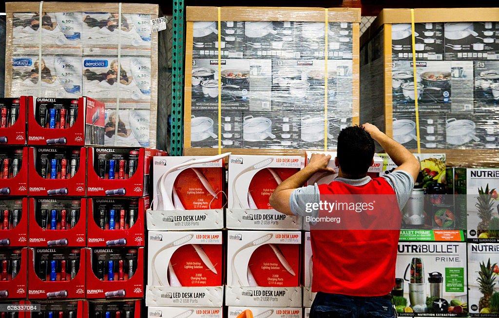 An employee restocks merchandise inside a Costco Wholesale