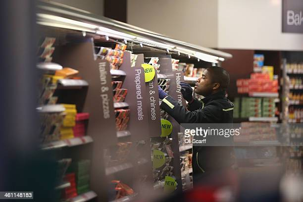 An employee restocks the shelves in a 'Simply Food' branch of Marks Spencer on January 7 2014 in London England The food and clothing retailer which...
