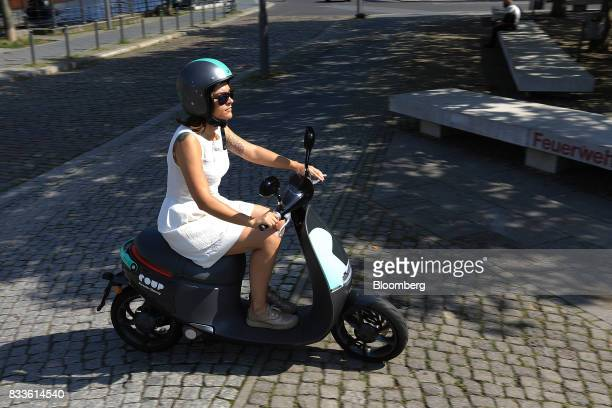 An employee rides a Coup eScooter electric hire vehicle operated by Robert Bosch GmbH in Berlin Germany on Thursday Aug 17 2017 Coup is one of Boschs...