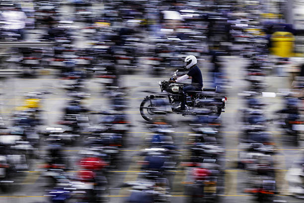An employee rides a Royal Enfield Motors Ltd Classic 350 motorcycle at the company`s manufacturing facility in Chennai India on Tuesday July 14 2015..