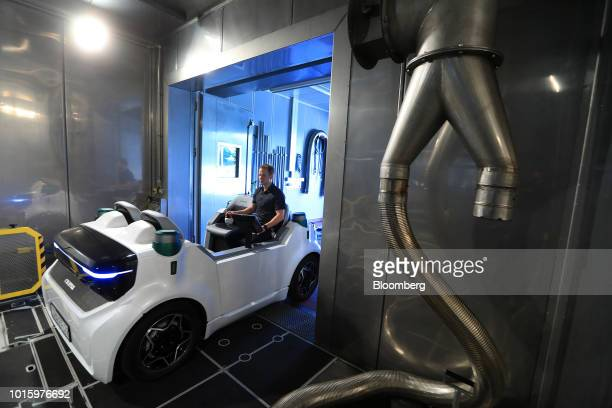 An employee rides in a Schaeffler Mover electric autonomous vehicle during testing in the Schaeffler AG factory in Herzogenaurach Germany on Tuesday...