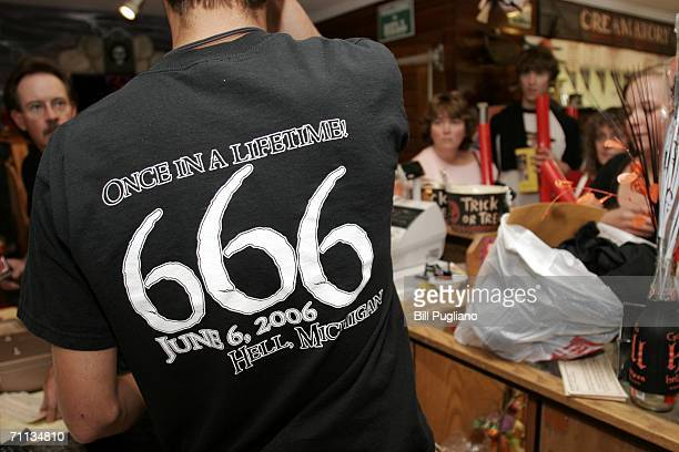 An employee rings up '666' merchandise to mark the date 666 at Screams Ice Cream shop June 6 2006 in Hell Michigan According to the Bible's Book of...