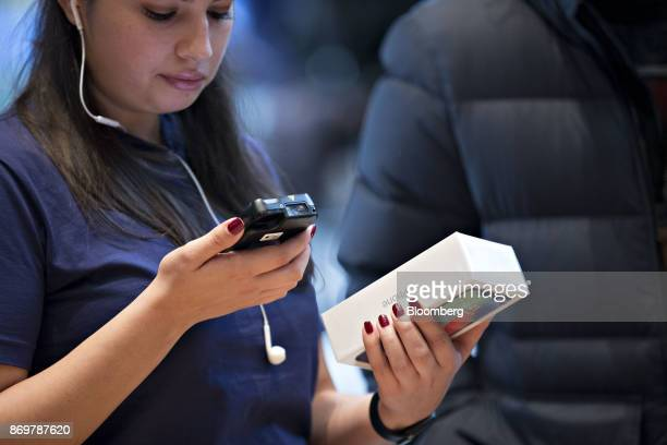 An employee rings up an Apple Inc iPhone X smartphone during the sales launch at a store in Chicago Illinois US on Friday Nov 3 2017 The $1000 price...