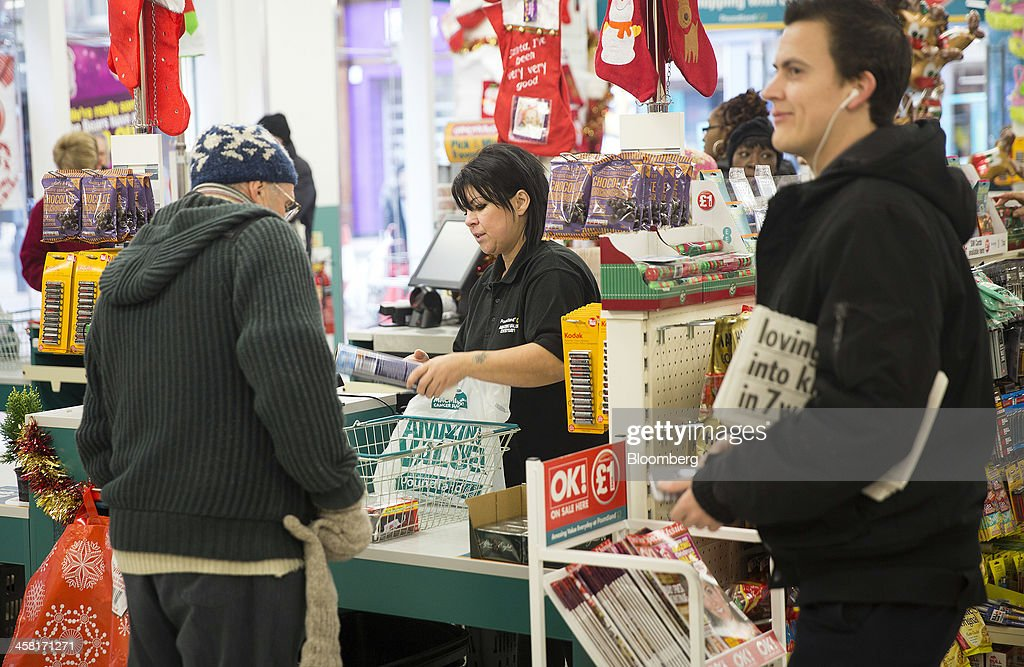 An employee scans a customers goods at a check-out desk inside a Poundland discount store, operated by Poundland Holdings Ltd., in Birmingham, U.K., on Friday, Dec. 20, 2013. U.K. discount retailer Poundland has hired Rothschild to manage its IPO, according to the Sunday Times newspaper. Photographer: Simon Dawson/Bloomberg via Getty Images