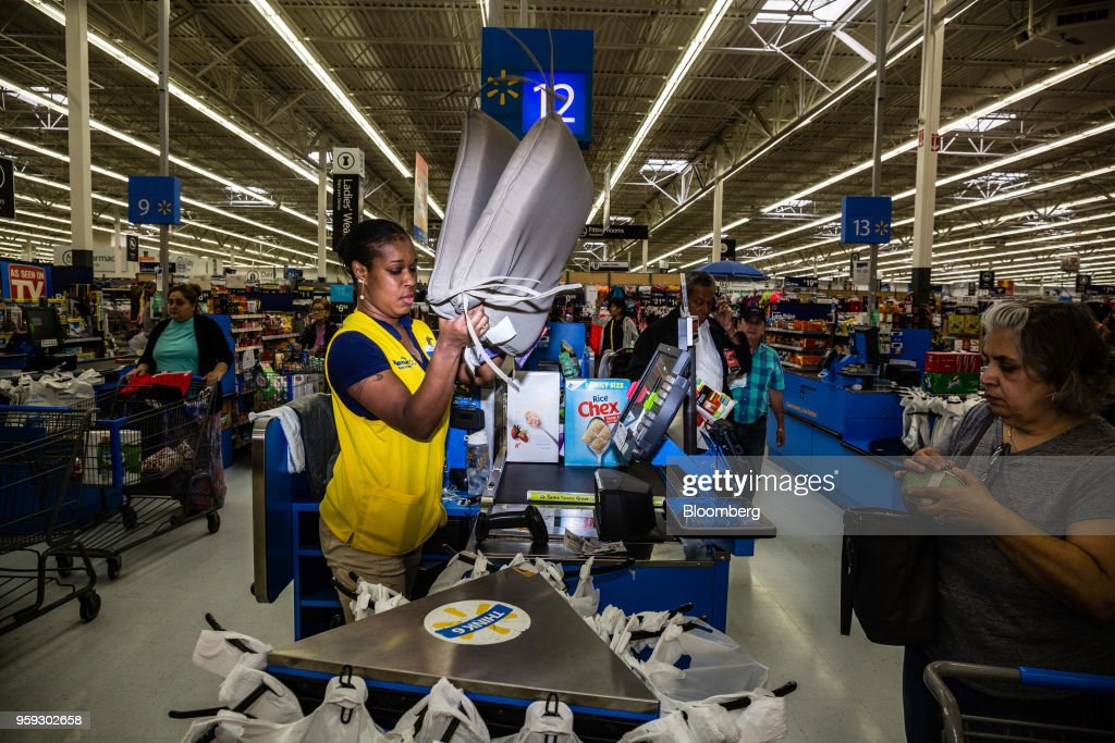An employee scans a customer's purchases at a Walmart Inc. store in Secaucus, New Jersey, U.S., on Wednesday, May 16, 2018. Walmart is scheduled to release earnings figures on May 17. Photographer: Timothy Fadek/Bloomberg via Getty Images