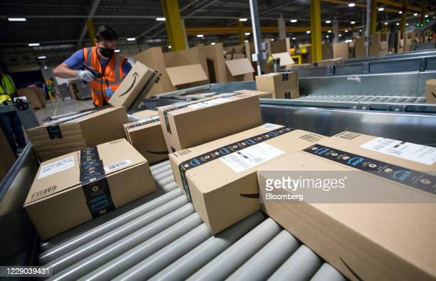 An employee scans a package at an Amazon.com Inc. Fulfilment center in Kegworth, U.K., on Monday, Oct. 12, 2020. Prime Day, a two-day shopping event...