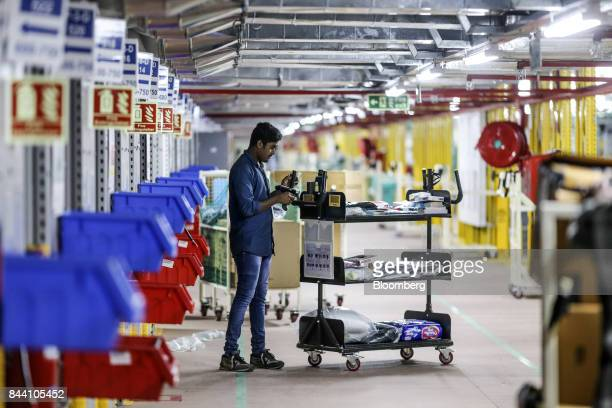 An employee scans a product for shipment at the Amazoncom Inc fulfillment center in Hyderabad India on Thursday Sept 7 2017 Amazon opened its largest...