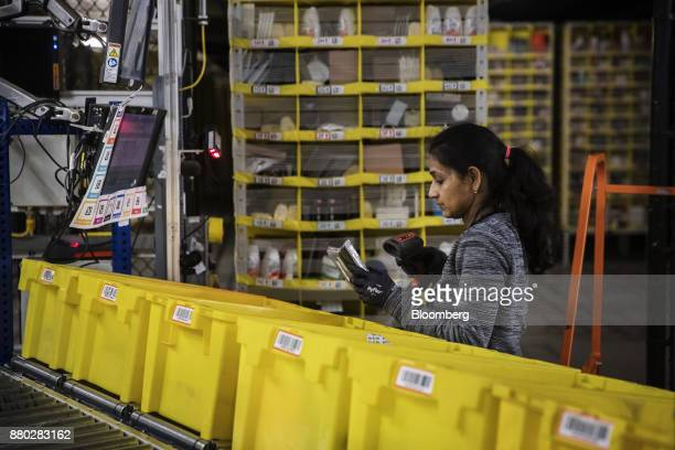 An employee scans an item while filling an online order at the Amazoncom Inc fulfillment center in Robbinsville New Jersey US on Monday Nov 27 2017...