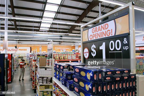 An employee scans merchandise inside a Family Dollar Stores Inc location in Mansfield Texas US on Tuesday Jan 7 2014 Family Dollar Stores Inc is...