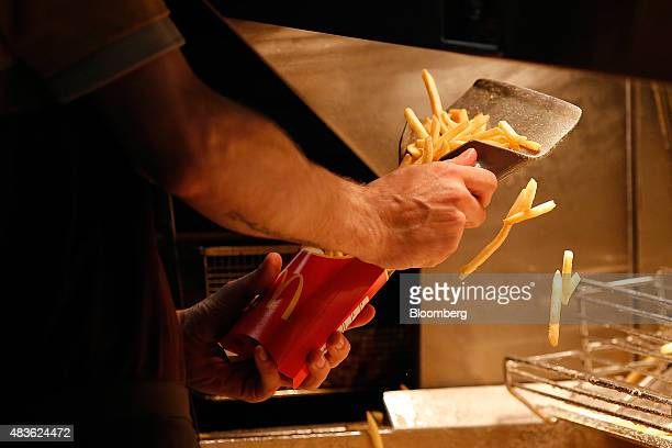 An employee scoops fries into a carton inside a McDonald's Corp restaurant in Manchester UK on Monday Aug 10 2015 McDonald's Chief Executive Officer...
