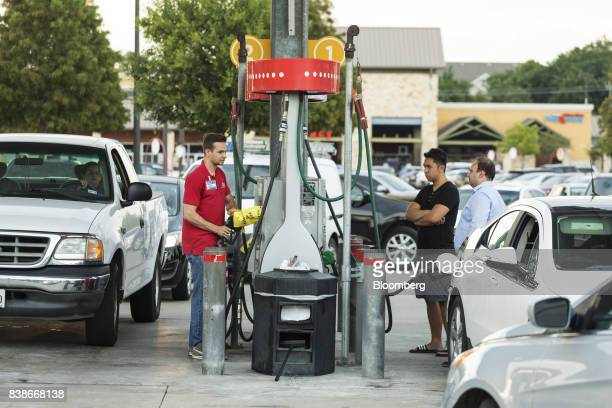 An employee second left informs customers of fuel shortage at an HEB Fuel gas station in Houston Texas US on Thursday Aug 24 2017 Hurricane Harvey...