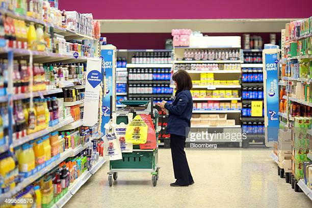 An employee selects items of shopping for home delivery at the Tesco Basildon Pitsea Extra supermarket operated by Tesco Plc in Basildon UK on...