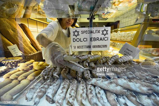 An employee serves a customer from a window of the Jewish bakery shop in the Ghetto on November 15 2011 in Venice Italy Established in 1516 the...