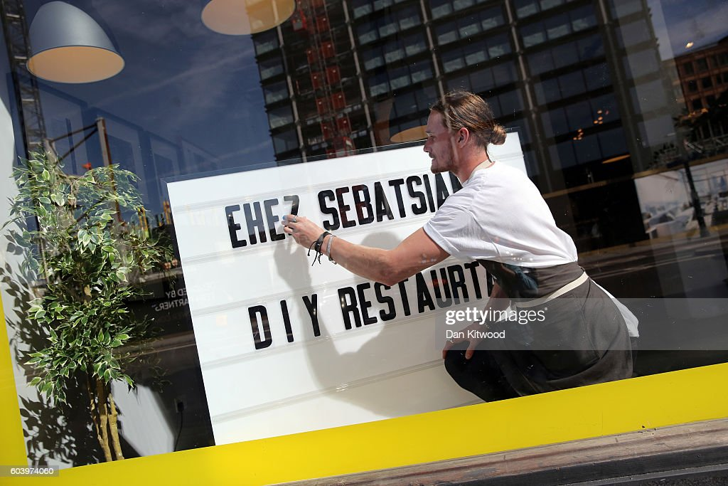 Britains first ikea pop up restaurant diy food at the dining an employee sets up a display inside ikeas the dining club pop up restaurant solutioingenieria Images