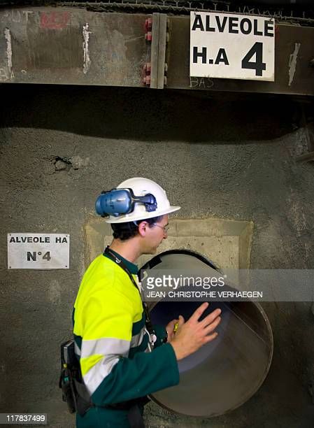 An employee shows a 70centimetrediameter boreholes called alveolus made to store nuclear waste 490m deep at the Underground Laboratory at Bure...