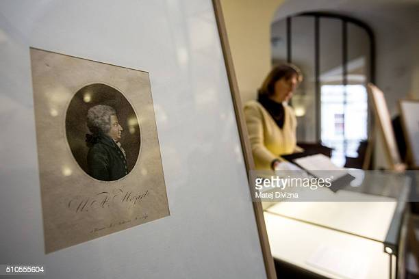 An employee shows piece of the cantata 'Per la Ricuperata Salute di Offelia' created by composers Wolfgang Amadeus Mozart and Antonio Salieri and an...