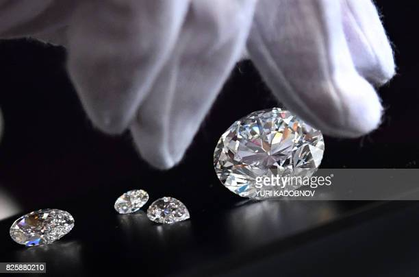 An employee shows the main 5138carat roundcut diamond the Dynasty among other gems from Russian diamond miner Alrosas Dynasty polished diamonds...