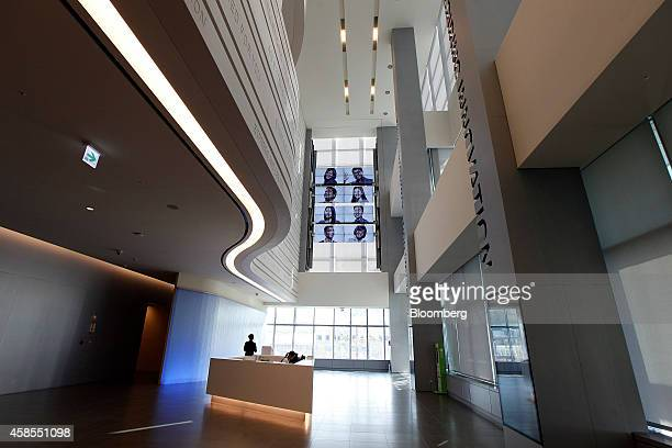 An employee sits at a reception desk inside the Samsung Innovation Museum operated by Samsung Electronics Co in Suwon South Korea on Wednesday Nov 5...