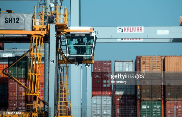 An employee sits in a straddle carrier on the dockside at London Gateway port operated by DP World Plc in StanfordleHope UK on Tuesday Sept 22 2020...