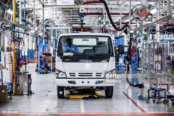 An employee sits in the cabin of an Isuzu NPR NSeries truck on the assembly line inside the Isuzu East Africa Ltd plant in Nairobi Kenya on Thursday...