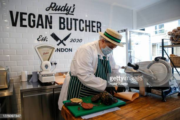An employee slices vegan meat alternatives on opening day at Rudy's Vegan Butcher on November 1, 2020 in London, England. The team behind Rudy's...