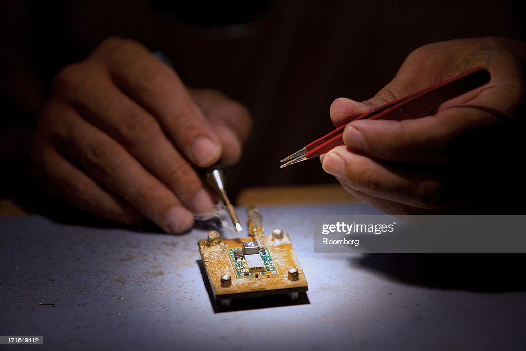 An employee solders a contact pin onto a circuit board for ProVari model electronic cigarettes at the ProVape Inc. facility in Monroe, Washington, U.S., on Wednesday, June 26, 2013. U.S. sales of electronic cigarettes are estimated to double in 2013 from last year, to $1 billion, according to estimates made by the Tobacco Merchants Association (TMA) and Mintel. Photographer: Mike Kane/Bloomberg via Getty Images
