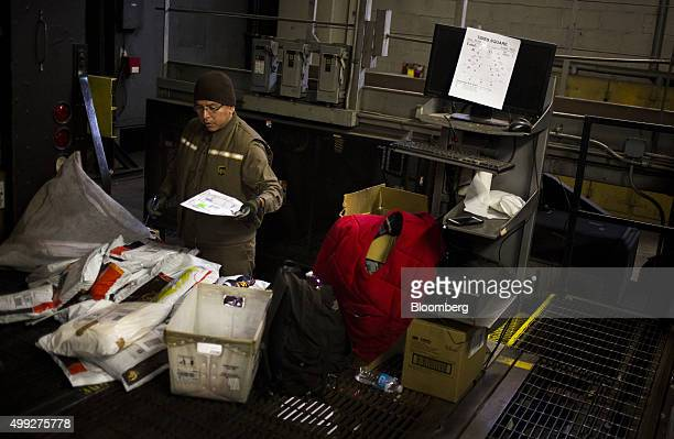 An employee sorts packages going out for delivery on Cyber Monday at a United Parcel Service Inc distribution facility in New York US on Monday Nov...