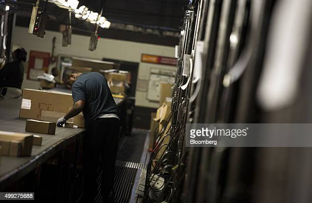 An employee sorts packages on Cyber Monday at a United Parcel Service Inc distribution facility in New York US on Monday Nov 30 2015 Online sales on...