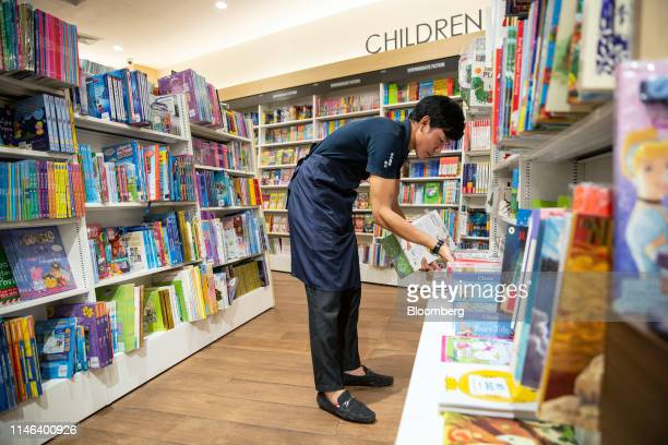 An employee sorts shelves in the children's section of the Kinokuniya Co book store at the Aeon Mall in Phnom Penh Cambodia Sunday May 26 2019...