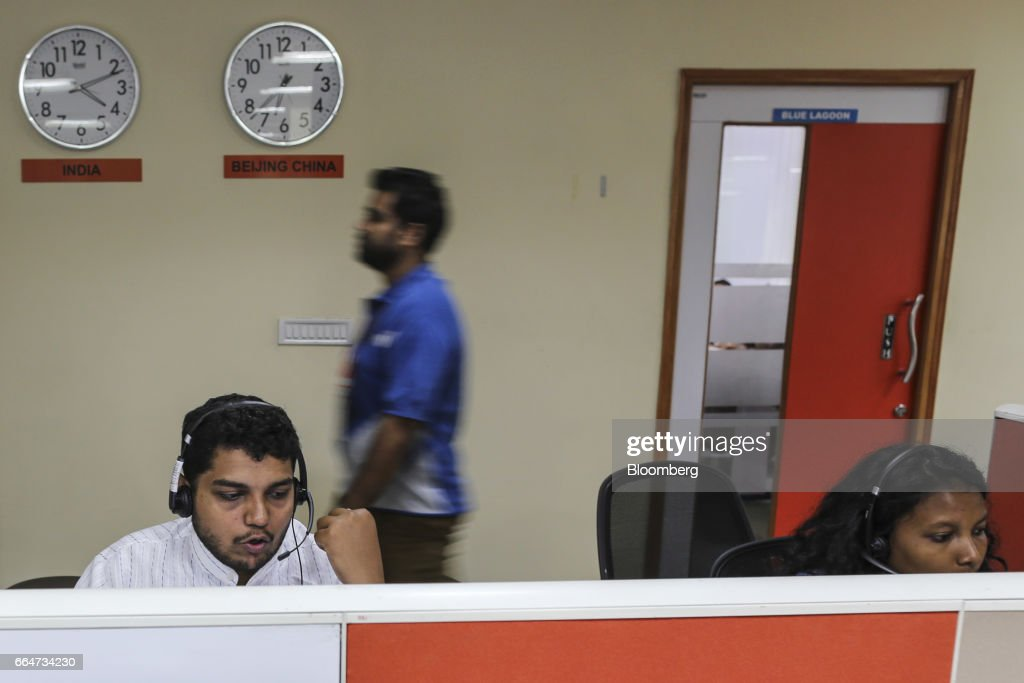 An employee speaks to a customer at a call center servicing