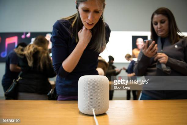 An employee speaks to Siri while demonstrating the Apple HomePod at an Apple store in New York in New York US on Friday February 9 2018 Mark...