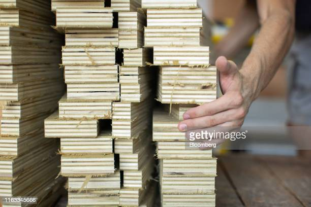 An employee stacks cut plywood at the CR Laine manufacturing facility in Hickory North Carolina US on Monday Aug 12 2019 President Trump's efforts to...
