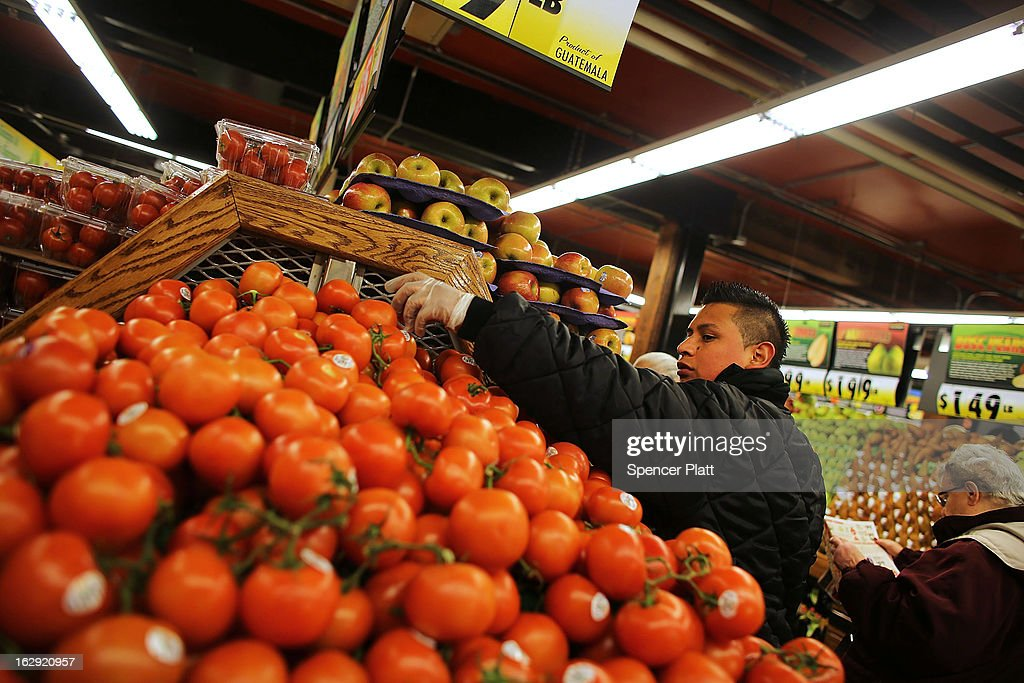 An employee stacks produce at the newly re-opened Fairway Market on the waterfront in Red Hook on March 1, 2013 in the Brooklyn borough of New York City. Fairway, which quickly became a popular shopping destination and an anchor in the struggling community of Red Hook, was closed following severe flooding during Hurricane Sandy on October 29, 2012. Like the rest of Red Hook, Fairway has struggled to quickly re-open in a neighborhood that lost dozens of businesses during the storm. The re-opening, which included a ceremony and ribbon cutting featuring Miss America and Mayor Michael Bloomberg, is being viewed as Red Hooks official comeback since the storm.