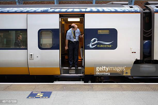An employee stands aboard a Eurostar train operated by Eurostar International Ltd as it waits to depart from a platform at St Pancras rail station in...
