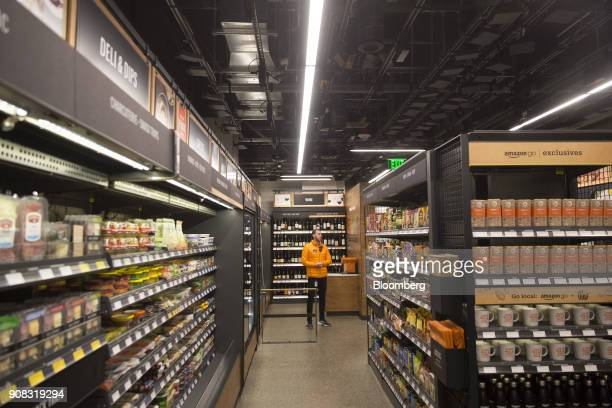 An employee stands at the Amazon Go store in Seattle Washington US on Wednesday Jan 17 2018 After more than a year of testing with an employeeonly...