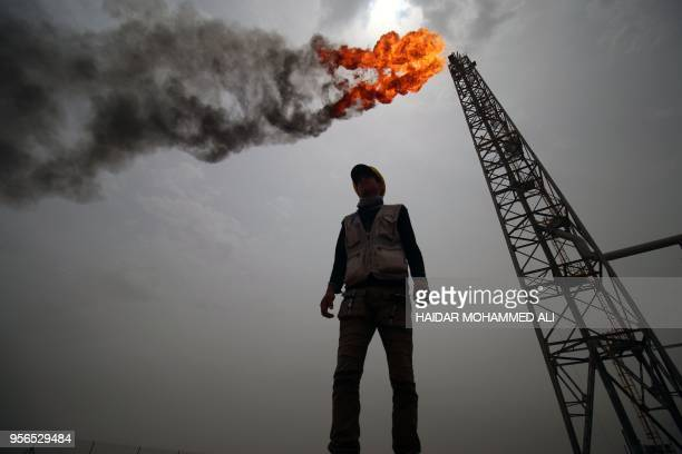 An employee stands at the Hammar Mushrif new Degassing Station Facilities site inside the Zubair oil and gas field, north of the southern Iraqi...
